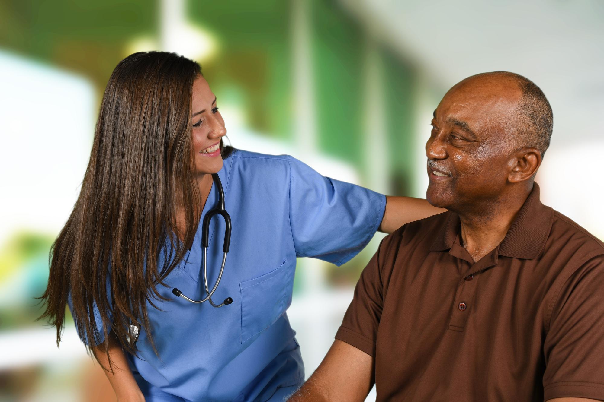 Caregiver Helping An Elderly Patient
